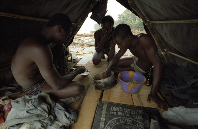 A makeshift shelter serves as kitchen and dormitory for the whole team.