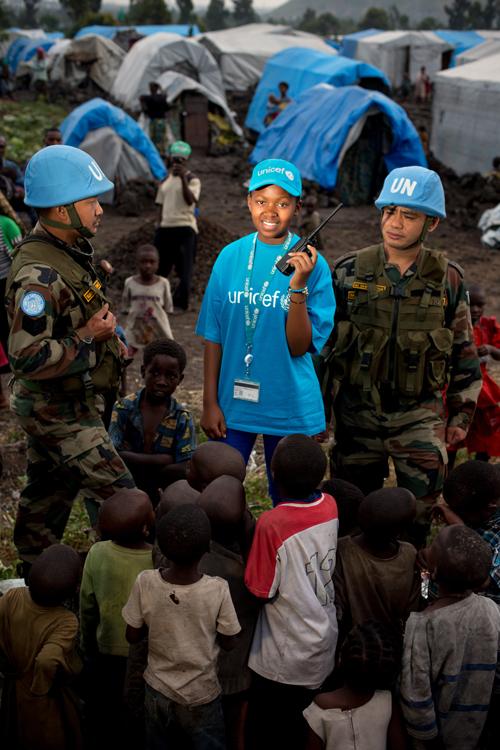 """Vanessa est une fille de 16 ans habitant à Goma, la capitale de la province du Nord-Kivu, une région en proie depuis vingt ans à des violences. Pour cette raison, sans doute, Vanessa rêve «d'être une personnalité importante dans le secteur humanitaire». Sérieuse et ambitieuse, Vanessa a déjà grimpé une marche vers son objectif en devenant la présidente du parlement des enfants du Nord-Kivu. / Vanessa is a 16-year-old girl living in Goma, the capital of the province of North Kivu, a region that has been ravaged by violence for twenty years. For this reason, undoubtedly, Vanessa dreams of """"being an important personality in the humanitarian sector"""". Serious and ambitious, Vanessa has already climbed a step towards her goal by becoming the president of the Children's Parliament of North Kivu."""