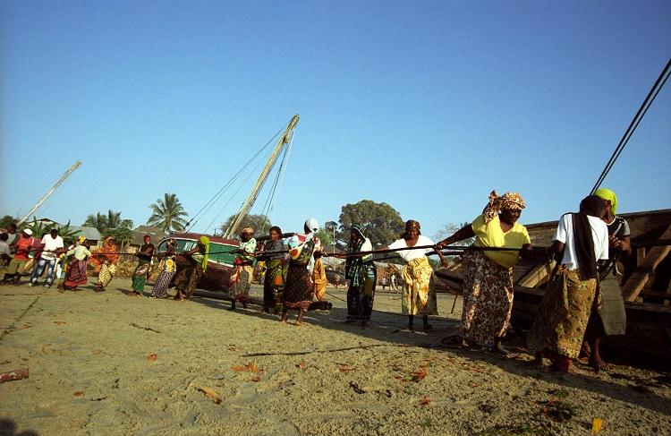 Women helping fishermen