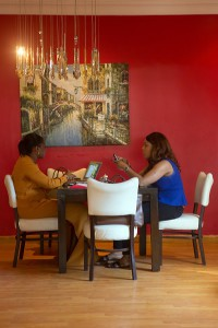 Two Nigerian women are having a business meeting at the Bistrot 7th Heaven on Victoria Island, Lagos, Nigeria