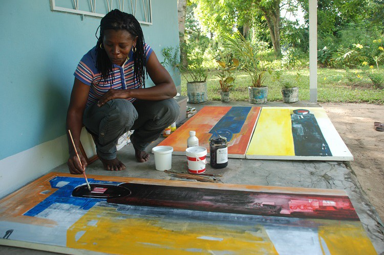 The artist working on an oil triptych.